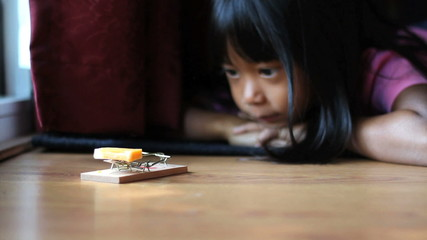 Girl Using A Mousetrap