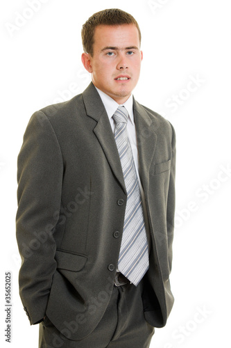 Serious businessman on white background.