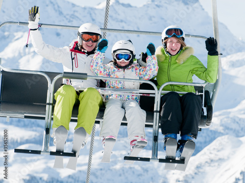 Ski lift - happy skiers on ski  vacation - 35652800