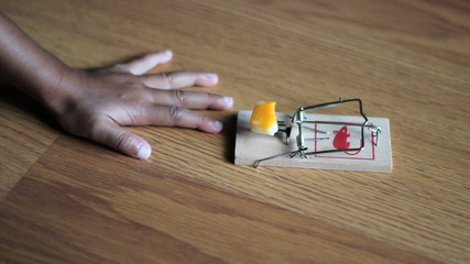 Little Girl Testing A Mouse Trap