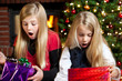 two girl surprised of their christmas presents
