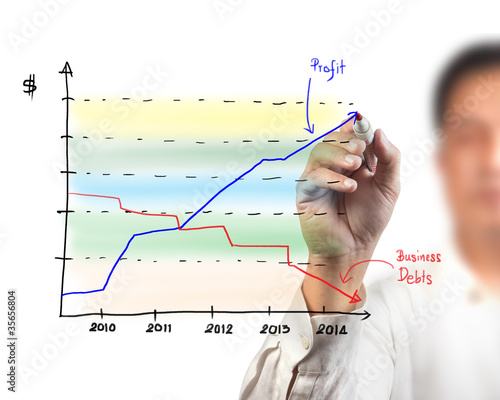 Business man drawing a graph on a glass window in an office - fo