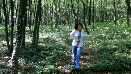 Woman running through the woods