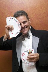 Magician performing with cards