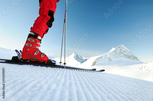 skier on an untouched ski track - 35659807