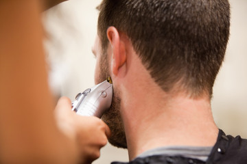 Young man having a haircut