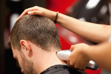 Close up of a male student having a haircut