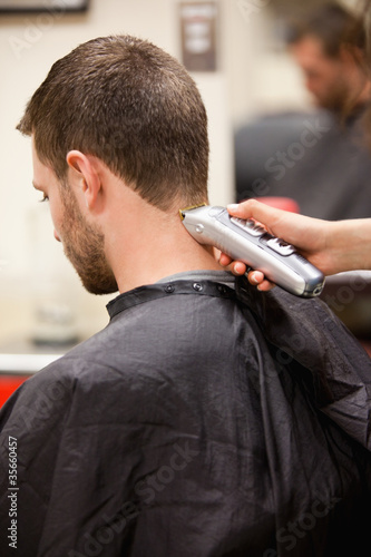 Portrait of man having a haircut