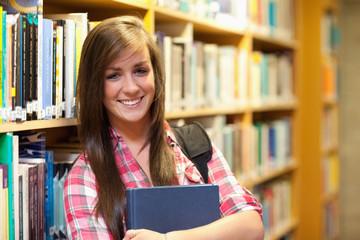 Smiling female student posing