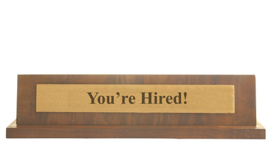 Isolated nameplate with You're Hired text on it