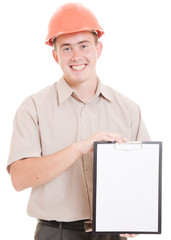 Businessman in helmet holding a tablet.