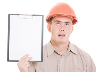 Businessman in helmet holding a tablet.