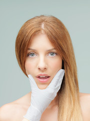 beautiful woman examined plastic surgeon scared expression