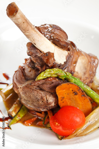 lamb chops on a bed of vegetables