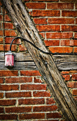 high-voltage socket of a brick house wall