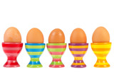 Colorful row with eggs in cups