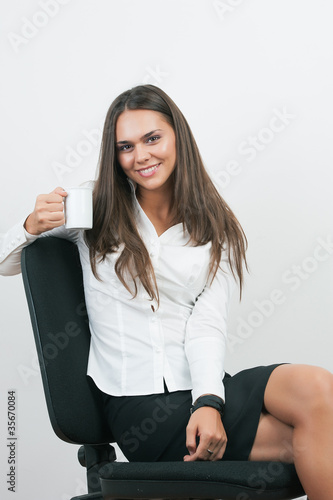 Business Woman Writing notes at desk isolated on white.