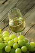 wine and grapes on wooden table