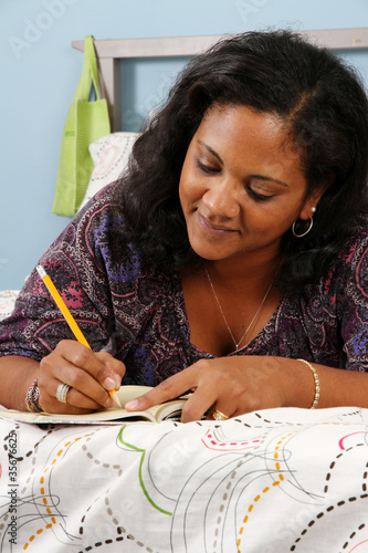 Woman On Bed Writing