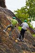 Father and son do cliff abseiling recreation in Thailand