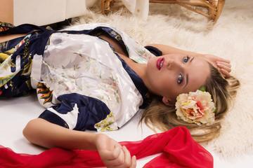 Sexual pretty girl lying on the floor