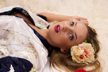 Pretty girl lying on the floor