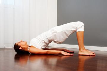woman doing yoga on floor
