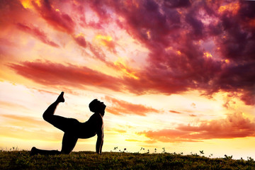 Yoga silhouette parshva marjariasana cat pose