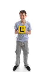 Teen boy holding L learner plates