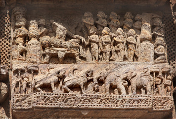 Beautifully carved courtly scene and war horses and elephants
