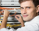 The engineer in a data processing center of Service Provider poster