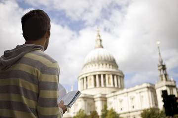 A man standing in front of St Paul's cathedral