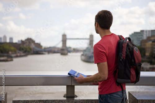 A man looking down the river Thames towards Tower Bridge