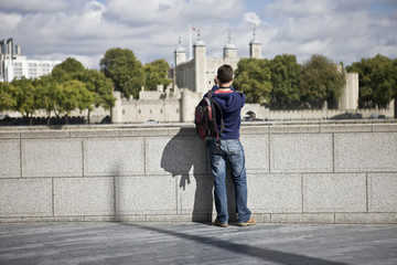 A man taking a photograph of the Tower of London