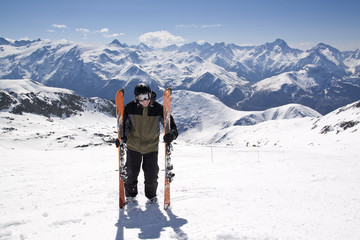 Young skiing man standing in snow mountain landscape