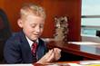 Cute boy in business attire in an office