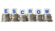 Stacks of coins with the word ESCROW isolated on white