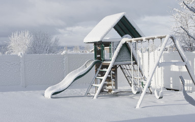 A playground covered in freshly fallen snow