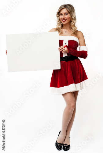 Pin up santa girl holds blank sign
