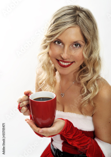 Pin up santa girl drinks coffee