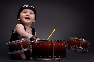 dark portrait of  Beautiful boy playing the drums