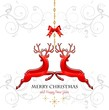 Red reindeer decorations hanging white background