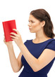 calm and serious woman with book