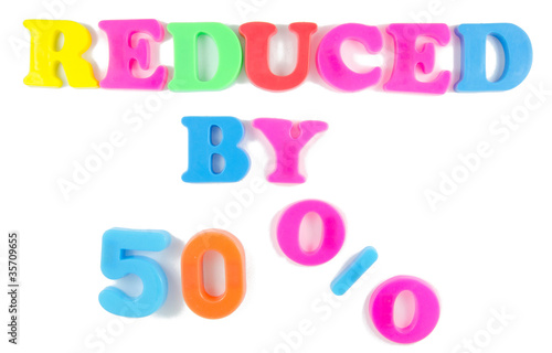 reduced by 50% written in fridge magnets