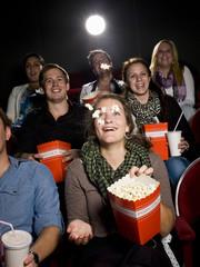 Eating popcorn at the cinema