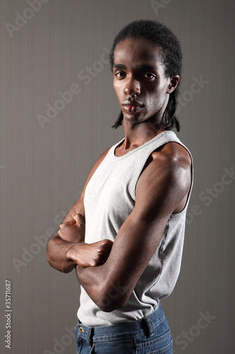 Tough young black man bicep and shoulder muscles