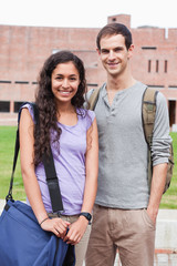 Portrait of a smiling student couple posing
