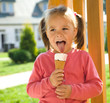 Little girl is eating ice-cream