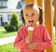 Little girl is eating ice-cream