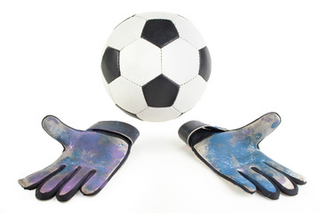 Soccer goalkeeper gloves and a ball